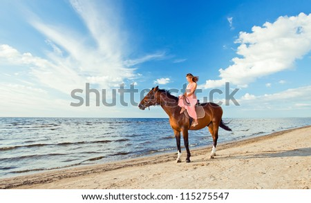 beautiful girl in dress with horse on seacoast - stock photo