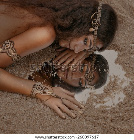 Beautiful girl in ethnic jewelry - stock photo