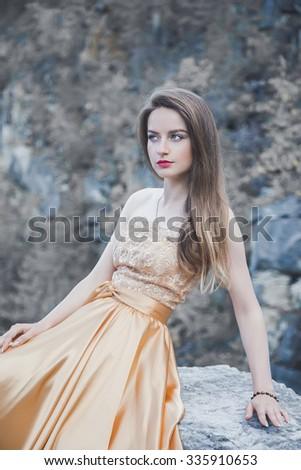 Beautiful girl in evening dress - stock photo