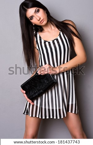 beautiful girl in evening dress with a clutch - stock photo