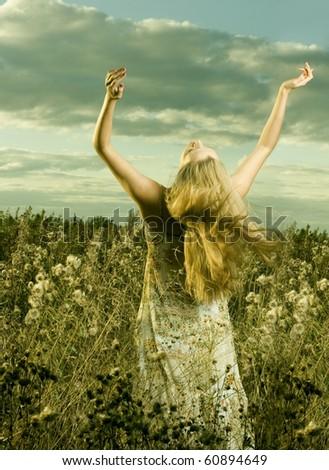Beautiful girl in field - stock photo