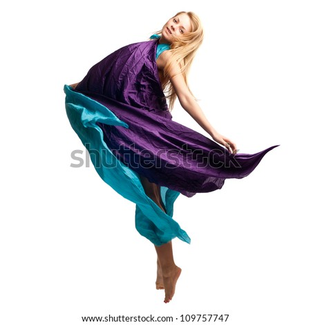 Beautiful girl in flying dress - stock photo