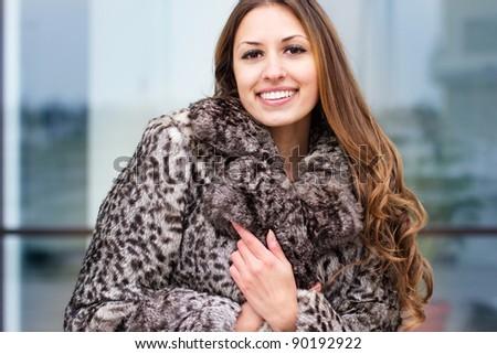 beautiful girl in fur coat in winter - stock photo