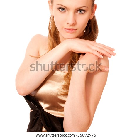 Beautiful girl in golden dress has put palms on shoulder, it is isolated on white background. - stock photo