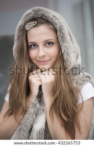 beautiful girl in grey fur hood, close up  - stock photo