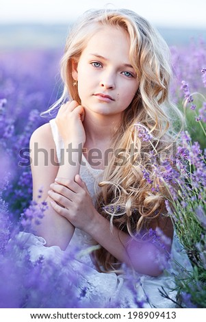 Beautiful Girl in Lavender Field - stock photo