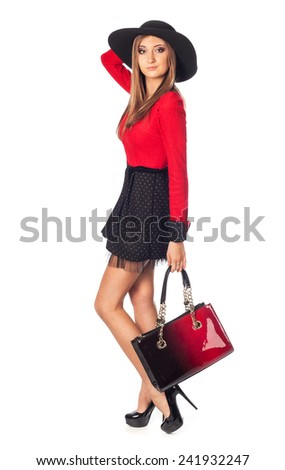 Beautiful girl in red - stock photo