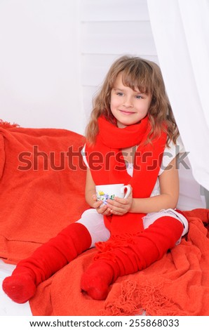 beautiful girl in red scarf on white wall - stock photo