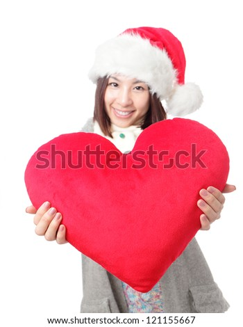 Beautiful girl in Santa hat holding big love heart shape pillow isolated on white background, asian beauty - stock photo