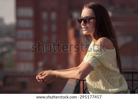 Beautiful girl in sunglasses enjoying the freshness. Sunset summer. - stock photo