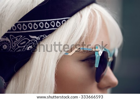 Beautiful girl in sunglasses outdoors - stock photo