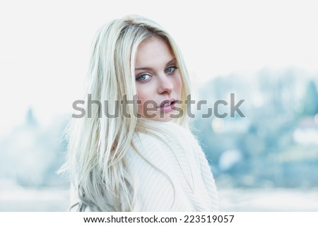 Beautiful girl in sweater freezing outdoor - stock photo