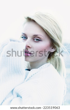 Beautiful girl in sweater freezing outdoor close-up portrait - stock photo
