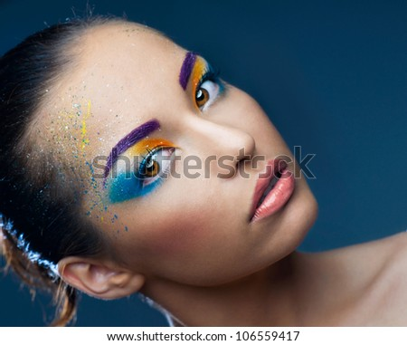 Beautiful girl in the bright makeup - stock photo