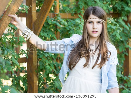 beautiful girl in the garden on a sunny day - stock photo
