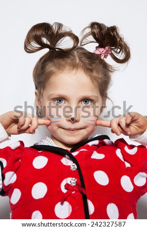 Beautiful girl in the photo studio on a white background in a red dress in white peas in the form of a mouse - stock photo