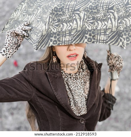 Beautiful girl in the rain with umbrella. focus on face - stock photo