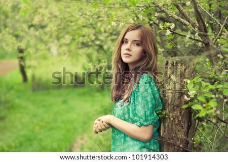 beautiful girl in the spring garden - stock photo