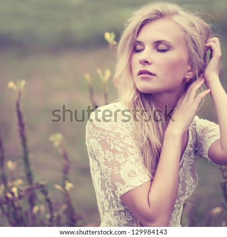 beautiful girl in the spring on a vintage photo - stock photo
