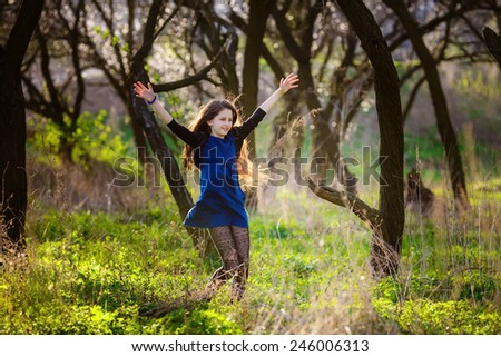 beautiful girl in the spring park - stock photo
