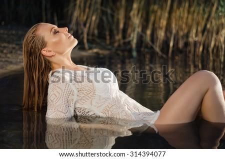 beautiful girl in the water - stock photo