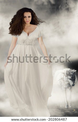 Beautiful girl in white dress with white wolf. Book cover - stock photo