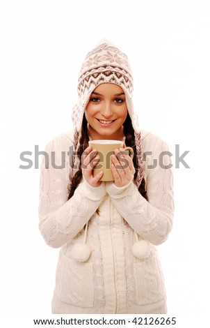 Beautiful girl in winter clothes holding cup on white background - stock photo