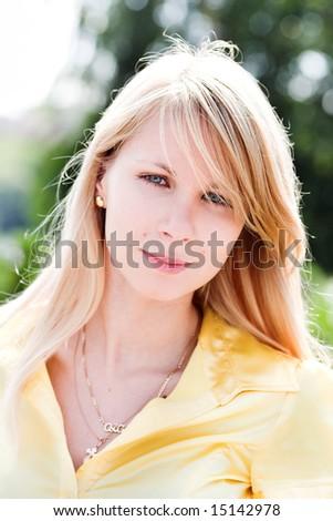 Beautiful girl in yellow - stock photo
