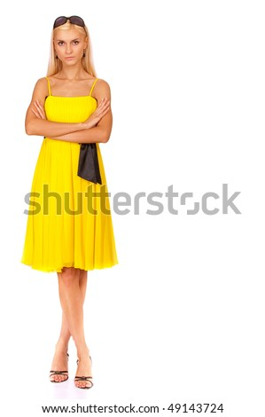 Beautiful girl in yellow dress to utmost, it is isolated on white background. - stock photo