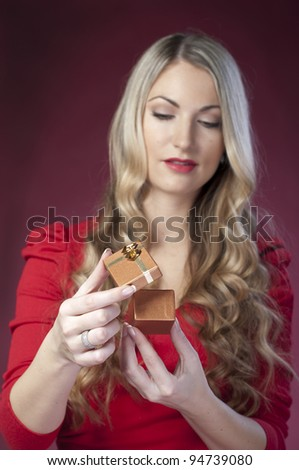 Beautiful girl is considering a gift to Valentine's Day - stock photo