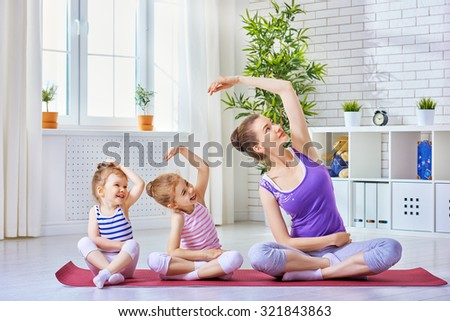 beautiful girl is engaged in yoga - stock photo