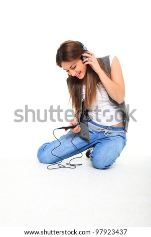 Beautiful girl is listen to the music - stock photo