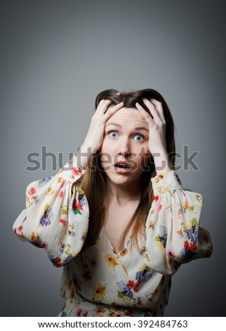 Beautiful girl is shocked. Emotions concept. - stock photo