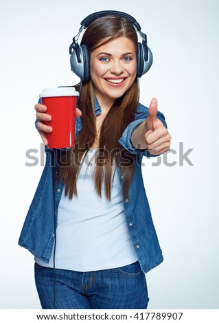 Beautiful girl listening music with coffee glass. Smiling young woman.  - stock photo