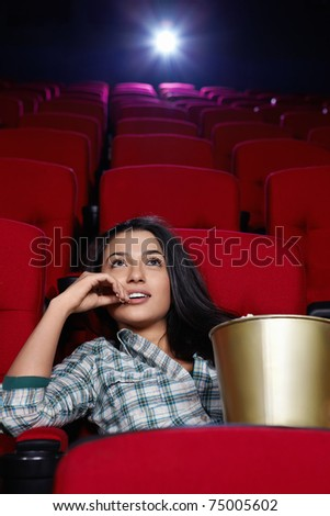 Beautiful girl looking movie - stock photo