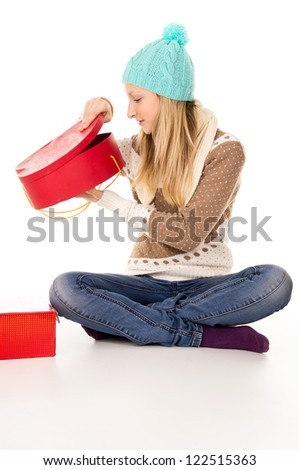 beautiful girl looks in a gift isolated - stock photo