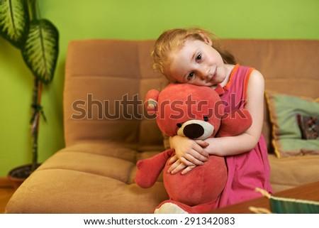 beautiful girl loves pink teddy bear - stock photo