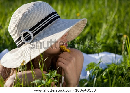 Beautiful girl lying in grass - stock photo