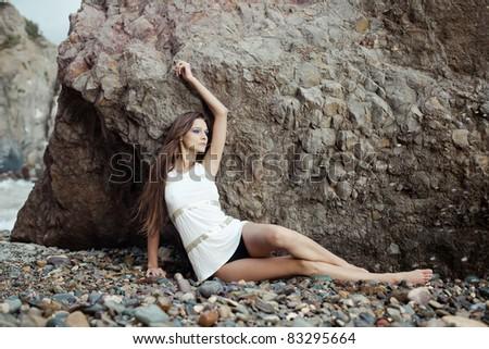 beautiful girl lying on the beach - stock photo
