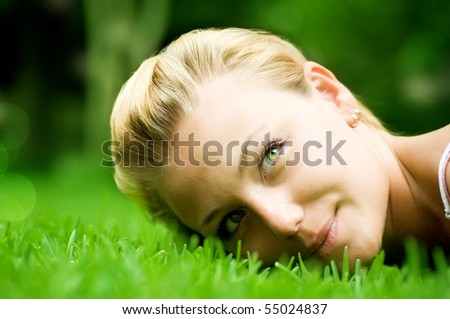 Beautiful Girl lying on the grass - stock photo