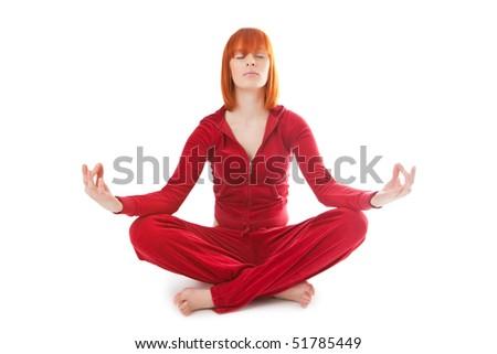 Beautiful girl meditates on a white background - stock photo