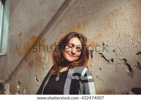 beautiful girl near old wall - stock photo