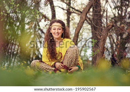 Beautiful girl of hippie in the field - stock photo