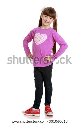 Beautiful girl of school age with very long bushy tails on the head and short bangs bravely standing in front of the camera. A girl wearing a pink shirt and long black pants-Isolated on white - stock photo