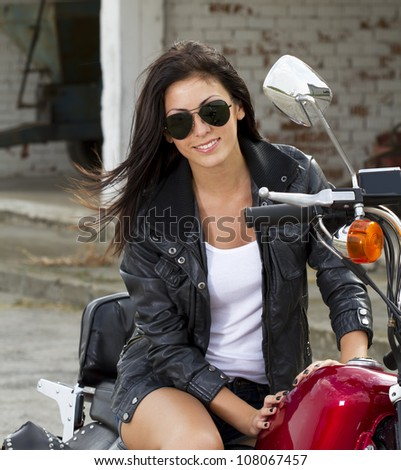 Beautiful girl on a motorcycle - stock photo