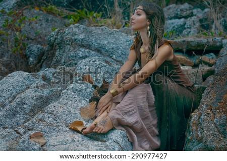 beautiful girl on a rock  - stock photo