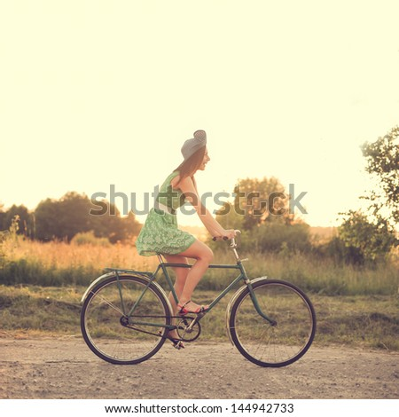 beautiful girl on a vintage bike - stock photo