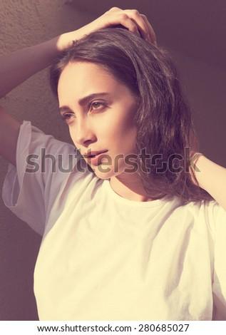 Beautiful girl on a warm sunny day - stock photo