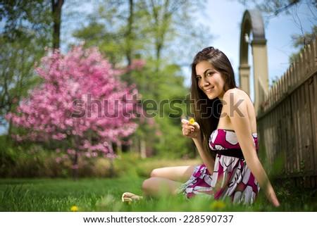 beautiful girl on grass lawn - stock photo