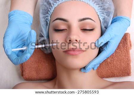 Beautiful girl on rejuvenation procedure in beauty clinic - stock photo